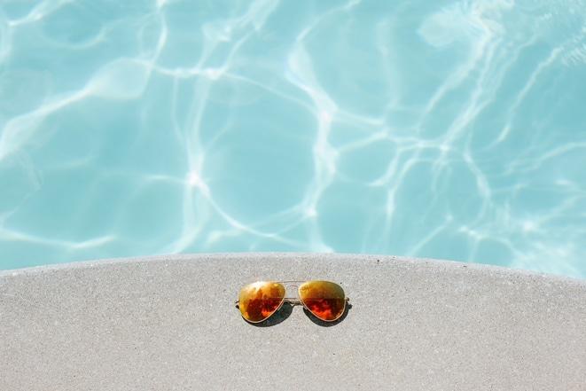 sunglasses on pool deck