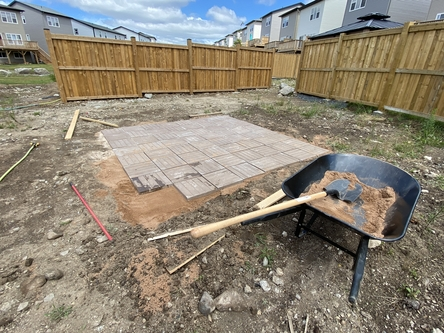 last paver stone to be added to patio