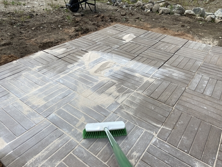 sweeping polymeric sand in paver cracks